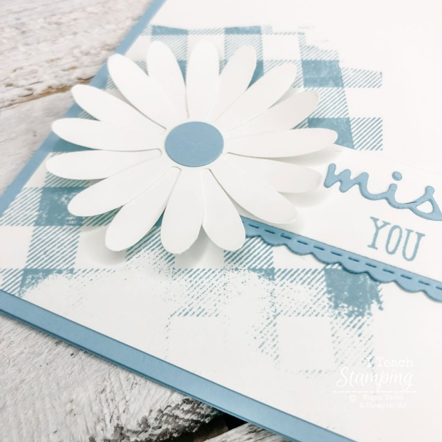 This closeup of a simple card design shows the details of the paper daisy - come learn more!