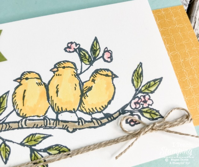 Three handstamped and hand colored birds on a branch from a greeting card for friend support